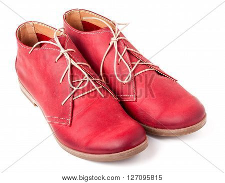 red women's leather shoes with laces isolated on white background.