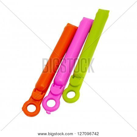 Three clothespins on a white background