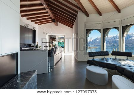 Interior of a loft, wide living room, kitchen view