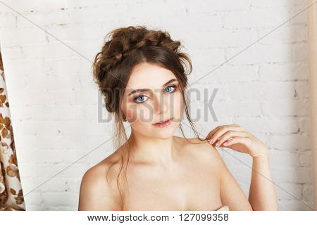 Beautiful Face of Young Woman with Clean Fresh Skin and nice makeup close up. Beauty Portrait. Beautiful Woman Smiling. Perfect Fresh Skin. Pure Beauty Model. Youth and Skin Care Concept, High key.