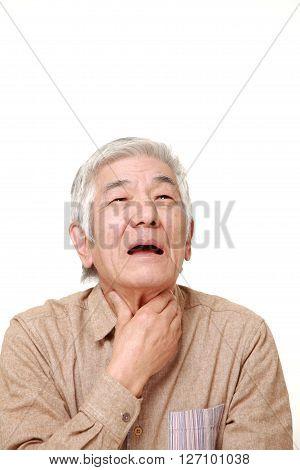 studio shot of senior Japanese man having throat pain on white background