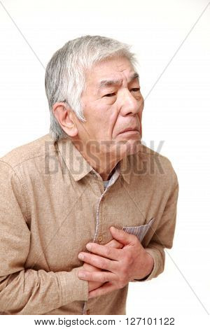 studio shot of senior Japanese man heart attack on white background