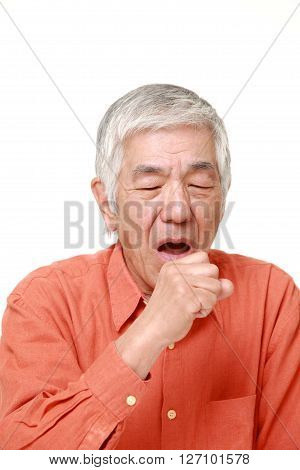senior Japanese man coughing on white background