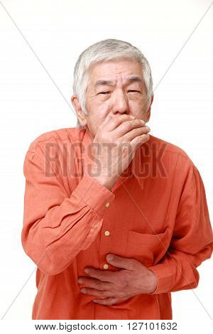 portrait of senior Japanese man feels like vomiting on white background