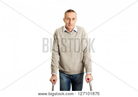 Disabled mature man with crutches