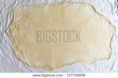 Homemade Phyllo Or Strudel Dough On A Home Table Cloth.