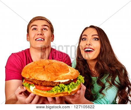 Man and woman eating big sandwich fastfood.  Isolated.