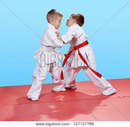 Judo sparring in perfoming young athletes on the mats