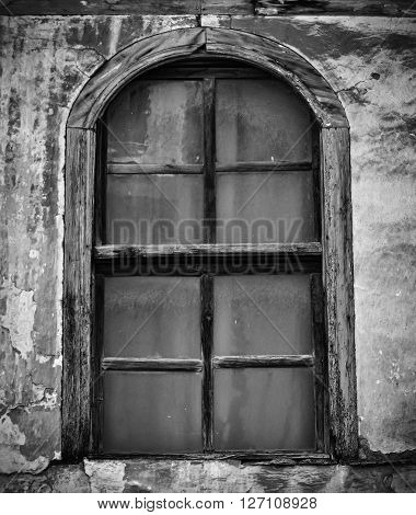 Closeup of an old rotted window in black and white colors