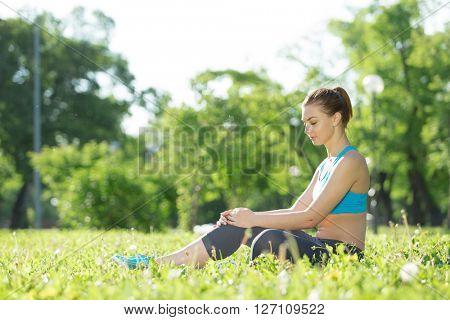 Woman meditating in park