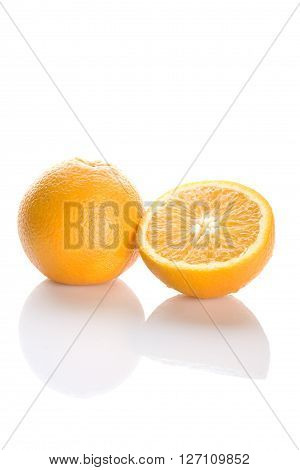 Two perfectly fresh oranges isolated on white