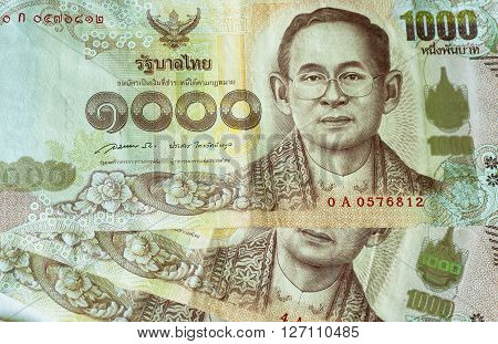 Thai Baht note printed with king's portrait and watermarks. Currency is the responsibility of the Bank of Thailand.