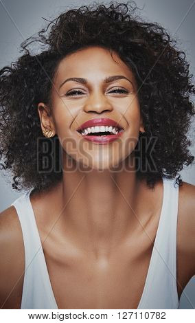 Close Up Of Laughing Female Leaning Forward