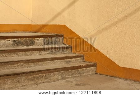 Old Stairway And Orange Wall.