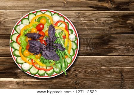 vegetables mix the plate on a wooden table