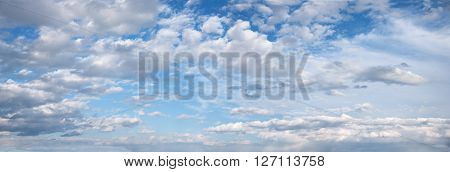 panoramic sky background with fluffy cumulus clouds