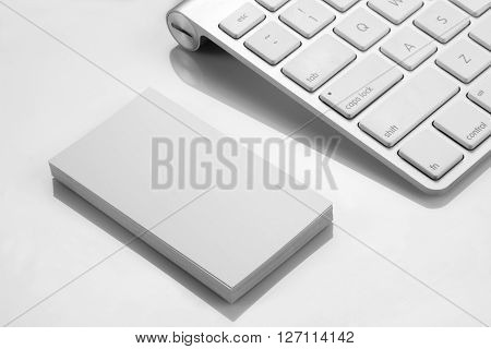Blank Business Card Mockup with a Keyboard on White Background
