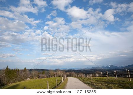 taubenberg hill in the bavarian foothills with view to the alps