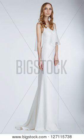 Bride in the studio in white dress