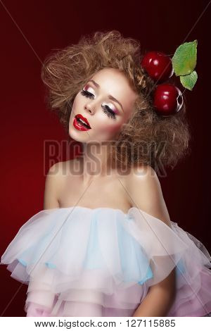 Woman With Artistic Make-up And Cherry.