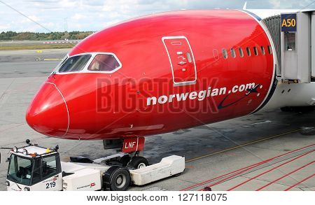 OSLO - AUG. 13: Norwegian Air Boeing Dreamliner 787 plane parked at Oslo Gardermoen airport on August 13, 2014. Low cost expanding destinations long haul flights are gaining market across the Atlantic