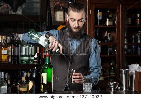 This is photo of expert barman is making cocktail.