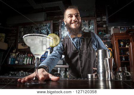 Barman Serving Cocktail.