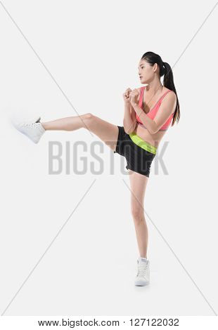 Full body Pretty young woman boxing on white background