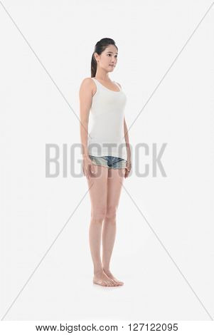 Full body young fitness trainer standing isolated over white background