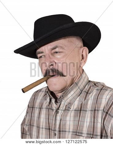 The cowboy with mustache in a black hat smoking a cigar