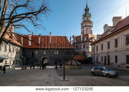 CESKY KRUMLOV CZECH REPUBLIC - DECEMBER 29 2015 : General view of Little Castle Tower in Cesky Krumlov colorful historical tower on bright blue sky background.