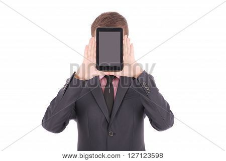 Boy in a black suit hold a tablet PC in front of his face isolated on white