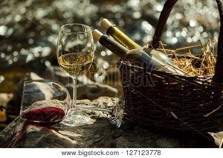Wine Glass And Bottles In Basket