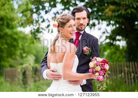 Wedding bride and groom with bridal bouquet