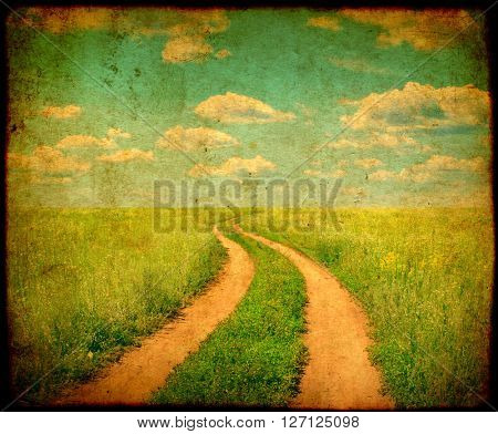 Grunge background with texture of old soiled paper and rural summer landscape with old road