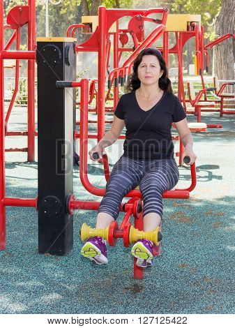 Woman in a sports simulator training on the playground outdoors