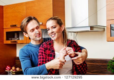 Young couple dancing and having fun in the kitchen