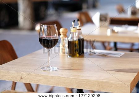 Glass of red wine in outdoor restaurant