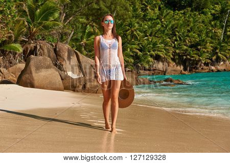 Woman with sarong on beach Anse Intendance at Seychelles, Mahe