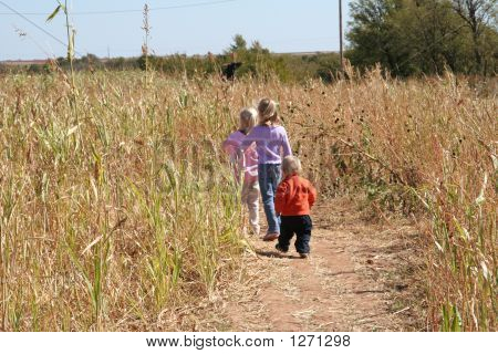 Children Strolling Through A Field