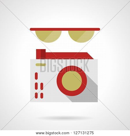Sunglasses and photo camera with red elements. Device and accessories for photography, journalism, tourism. Flat color style vector icon. Web design element for site, mobile and business.
