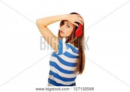 Teenage woman listening to music