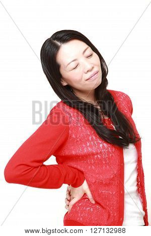 Japanese woman suffers from lumbago on white background