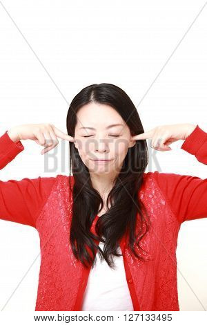Japanese woman suffers from noise on white background
