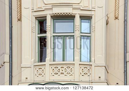 Triple Window at Beige Building in Ljubljana