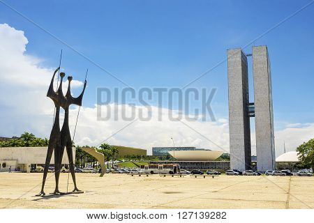Brasilia, Brazil - November 18, 2015: Brazilian National Congress (Congresso Nacional) building and Dois Candangos Monument in Brasilia, capital of Brazil.