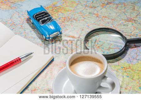 before holidays. planning travel with map and coffee