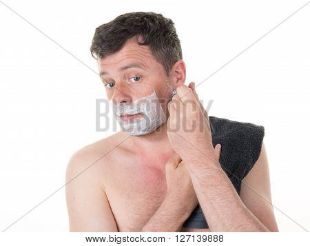 Lovely Man In Front Of Mirror Shaving In The Morning