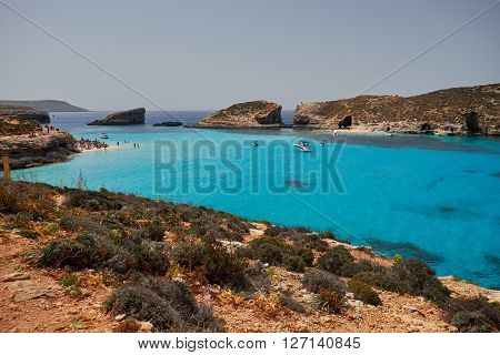 BLUE LAGOON/ COMINO ISLAND / MALTA /APRIL 13 2016 : People enjoying the sun and blue waters on the beach.