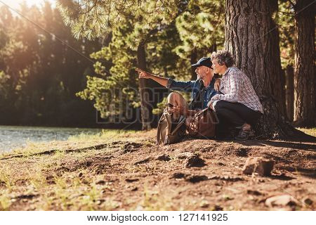 Senior Man And Woman On A Hike In Nature